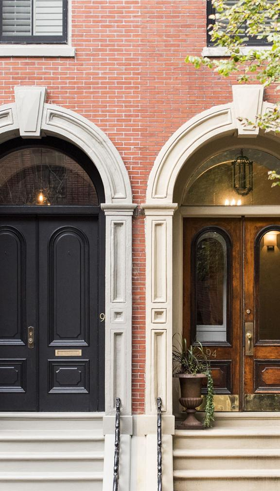 Two iconic brick house doorways in the style of Boston's Beacon Hill Federal houses and the row houses from Boston's south end