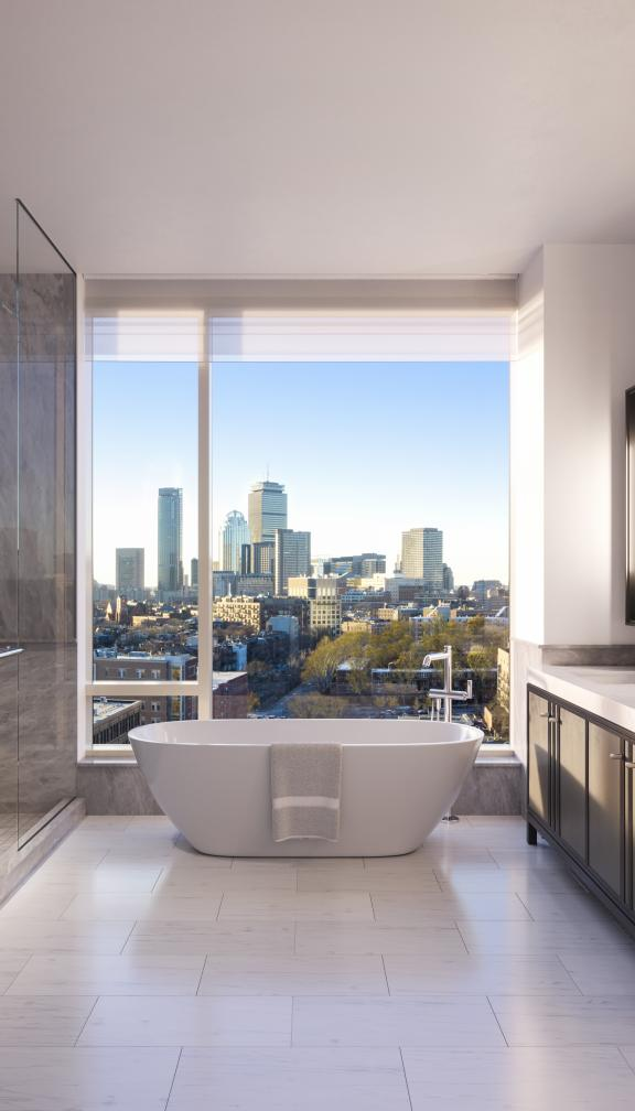 The Quinn penthouse bathroom and soaking tub with a breathtaking view of the city of Boston
