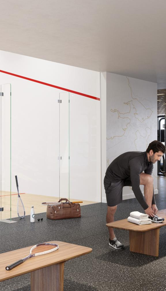 people playing squash in the court